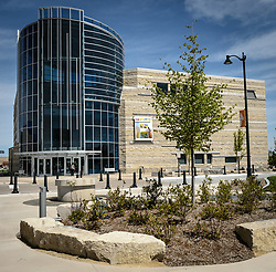 The $24.4 million Flint Hills Discovery Center, located in Manhattan, Kansas celebrates the history, culture, and heritage of the Flint Hills and tallgrass prairie. Through interactive exhibits Flint Hills Discovery Center visitors can explore the science and cultural history of the last stand of tallgrass prairie in North America &ndash; one of the world&rsquo;s most endangered ecosystems.<br /> <br /> The Flint Hills Discovery Center was designed by the museum architectural firm Vern Johnson Inc. with interpretive design and planning by Hilferty and Associates. The 34,900 square foot science and history learning center features permanent interactive exhibits, temporary exhibits, and areas for community programs and outreach activities.<br /> <br /> Attractions of the Flint Hills Discovery Center include: a 15-minute &lsquo;immersive experience&rsquo; film which has special effects such as fog, mist and wind which appear in the theater as the high definition film is shown on a large panoramic screen; an &lsquo;underground forest&rsquo; depicting the long roots of prairie plants including the 7-foot roots of bluestem prairie grass; explanations of importance of fire to the Flint Hills tallgrass prairie; and exhibits about the people and cultural history of the Flint Hills.<br /> <br /> The Flint Hills Discovery Center received a LEED green building certification for their environmental design and energy efficiency, including their lighting and geothermal heating/cooling system.