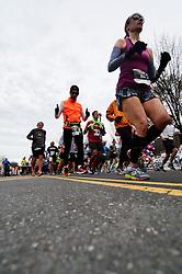 Teklu Deneke, of USA, and Gisele Olalde Granados, of MEX, win the November 22, 2015 Philadelphia Marathon on the Ben Franklin parkway in Center City Philadelphia, PA. A total of 25.000 runners compete in the half and full marathon. (Photo by Bastiaan Slabbers)<br /> <br /> License similar file: http://www.istockphoto.com/photo/start-of-philadelphia-marathon-79497755