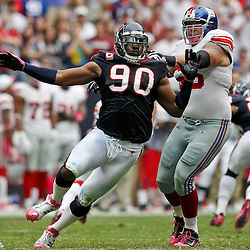 October 10, 2010; Houston, TX USA; Houston Texans defensive end Mario Williams (90) rushes against New York Giants offensive tackle David Diehl (66) at Reliant Stadium. Mandatory Credit: Derick E. Hingle