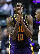 Feb. 21, 2012; Indianapolis, IN, USA; New Orleans Hornets center Solomon Jones (18) reacts after a call against the Indiana Pacers at Bankers Life Fieldhouse. Indiana defeated New Orleans 117-108. Mandatory credit: Michael Hickey-US PRESSWIRE