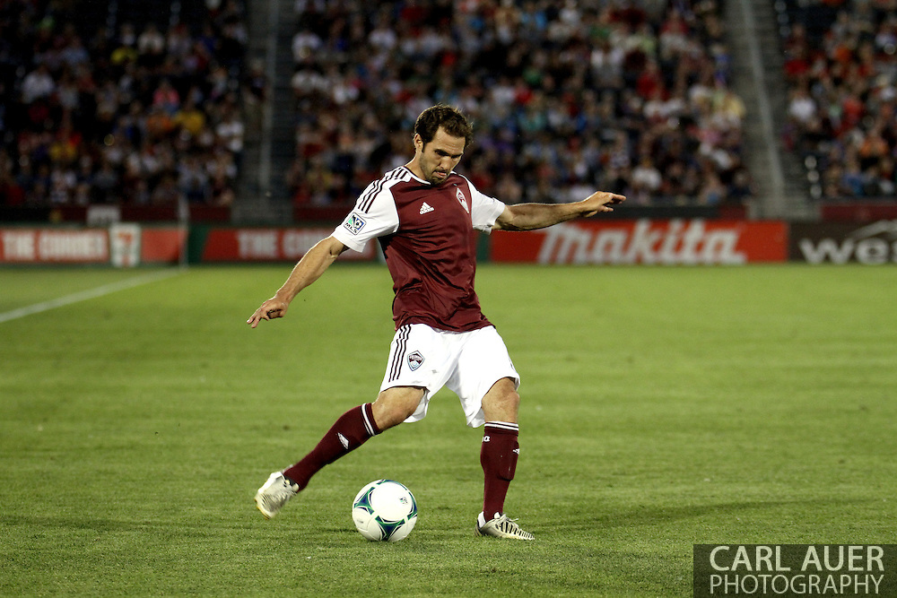 June 15th, 2013 - Colorado Rapids midfielder Brian Mullan (11) crosses a pass towards the goal in the second half of action in the MLS match between San Jose Earthquake and the Colorado Rapids at Dick's Sporting Goods Park in Commerce City, CO
