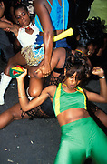 Ragga girls grinding with eath other. Notting Hill Carnival, London, UK 1997