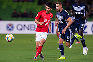 MELBOURNE, AUSTRALIA - APRIL 23: He Chao (13) of Guangzhou Evergrande clears the ball during the AFC Champions League Group Stage match between Melbourne Victory and Guangzhou Evergrande at AAMI Park on April 23, 2019 in Melbourne, Australia. (Photo by Speed Media/Icon Sportswire)