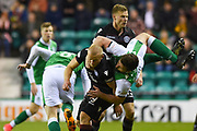 Darren McGregor tangles with Curtis Main during the Ladbrokes Scottish Premiership match between Hibernian and Motherwell at Easter Road, Edinburgh, Scotland on 31 January 2018. Picture by Kevin Murray.