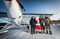 (From Right To Left: Bryan York, Greg Lingard, Johnny May, Bruce Turner) Pilot Johnny May flew his 50th annual Candy Drop in Kuujjuaq, Nunavik on December 29th, 2015. This was Bruce Turner's 19th drop and Bryan York's has more then 20. The drop drew nearly 1000 Kuujjuamiut. Gifts from Nunavik Rotors, First Air, Landholding, The Kuujjjuaq Recreation Department, Allan Gordon, Peter Duncan and many others included (but were not limited to) plane tickets, hats, sewing materials, cash prizes, clothing, gift certificates and others. Cold temperatures and high winds delayed the drop which normally takes place on Christmas day. While this was to be Johnny's last Candy Drop the legendary pilot stated that he will fly one more drop in 2016 to make up for not being able to fly on Christmas Day. Many Kuujjuamiut left in the days after Christmas.
