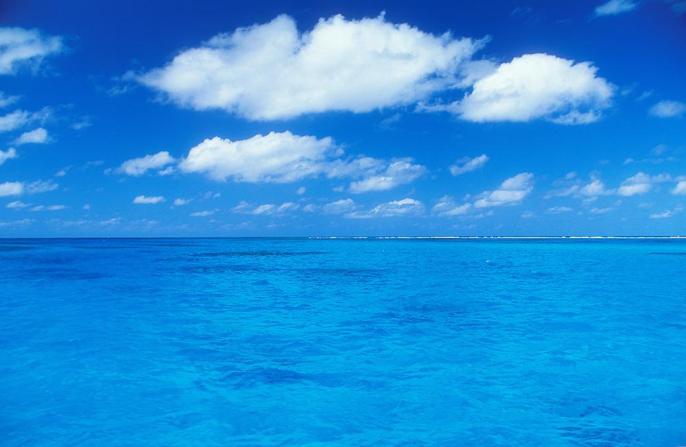 Ocean water, sky and white puffy clouds; Tanapag Lagoon, Saipan, Northern Marianas Islands.