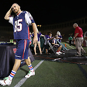 Mitch Belisle #85 of the Boston Cannons walks to receive a player award after getting his head shaved for charity following the game at Harvard Stadium on August 9, 2014 in Boston, Massachusetts. (Photo by Elan Kawesch)