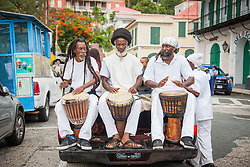 Drummers Keibo Brown, left, Afreekan Southwell, and Feba Reid play African-Caribbean rhythms to lead the walking tour.  10th Annual Dollar Fo' Dollar Culture & History Tour commemorating the anniversary of the successful protest  demanding better pay by Queen Coziah and the 19th century coal laborers in the streets of downtown Charlotte Amalie.  12 September 2015.  St. Thomas, VI.  © Aisha-Zakiya Boyd