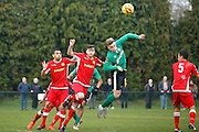 Burgess Hill defender Toby Pointing and Merstham Midfielder Michael Abnett contest for a header during the Ryman Premier League match between Merstham and Burgess Hill at Moatside, Merstham, United Kingdom on 31 December 2016. Photo by Andy Walter.