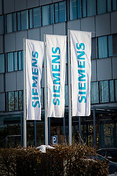 13.12.2010, Graz, AUT, Feature, im Bild Fahnen vor dem Hauptgebaeude von Siemens in Graz, EXPA Pictures © 2012, PhotoCredit: EXPA/ Erwin Scheriau