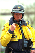 Police security age 34 at Cinco de Mayo festival.  St Paul Minnesota USA