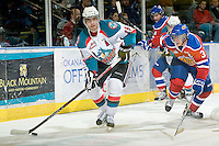 KELOWNA, CANADA - FEBRUARY 15: Brett Bulmer #19 of the Kelowna Rockets skates with the puck as Mark Pysyk #3 of the Edmonton Oil Kings skates for the puck against the Kelowna Rockets on February 15, 2012 at Prospera Place in Kelowna, British Columbia, Canada (Photo by Marissa Baecker/Getty Images) *** Local Caption *** Brett Bulmer;Mark Pysyk;