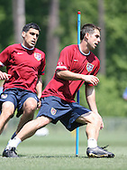 Carlos Bocanegra (r) and Claudio Reyna (l) during a fitness exercise on Wednesday, May 17th, 2006 at SAS Soccer Park in Cary, North Carolina. The United States Men's National Soccer Team held a training session as part of their preparations for the upcoming 2006 FIFA World Cup Finals being held in Germany.