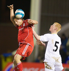 WARRINGTON, ENGLAND - Tuesday, February 26, 2008: Liverpool's Krisztian Nemeth and Manchester United's Richard Eckersley during the FA Premiership Reserves League (Northern Division) match at the Halliwell Jones Stadium. (Photo by David Rawcliffe/Propaganda)