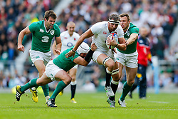 England Flanker Tom Wood is tackled by Ireland Hooker Rory Best and Winger Tommy Bowe - Mandatory byline: Rogan Thomson/JMP - 07966 386802 - 05/09/2015 - RUGBY UNION - Twickenham Stadium - London, England - England v Ireland - QBE Internationals 2015.