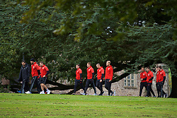 CARDIFF, WALES - Friday, October 7, 2016: Wales players stroll past Hensol Castle during a team walk at the Vale Resort ahead of the 2018 FIFA World Cup Qualifying Group D match against Georgia. James Collins, Chris Gunter, Tom Bradshaw, David Edwards, Andrew Crofts, goalkeeper Adam Davies, Emyr Huwsm Chris Gunter. (Pic by David Rawcliffe/Propaganda)