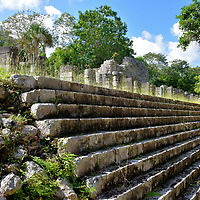 The Market at Chichen Itza, Mexico<br /> These wide stairs lead to a 250 foot long plaza formally covered by a roof suspended by columns. The space also has a sunken courtyard and temple ruins. The Spanish named this Toltec structure El Mercado. However, archeologists are not convinced it served as a marketplace when constructed between 900 &ndash; 1200 AD (Early Postclassic period).