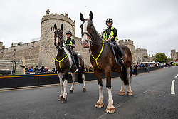 © Licensed to London News Pictures. 16/05/2018. Windsor, UK. Mounted police officers stand guard outside Windsor Castle as preparations for the Royal Wedding continue. Prince Harry and Meghan Markle are to be married on Saturday in Windsor. Photo credit: Rob Pinney/LNP