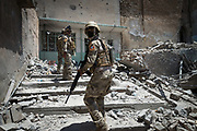 Iraqi soldiers in the Old City of Mosul search for remaining ISIS fighters on July 11, 2017.