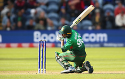 Bangladesh's Mustafizur Rahman is caught by England's Jonny Bairstow (not pictured) during the ICC Cricket World Cup group stage match at the Cardiff Wales Stadium.