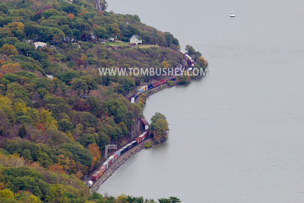 Bear Mountain, New York  - A freight trains heads north on the railroad track on the western shore of the Hudson River in a view from the top of Bear Mountain at Bear Mountain State Park on Oct. 24, 2014.