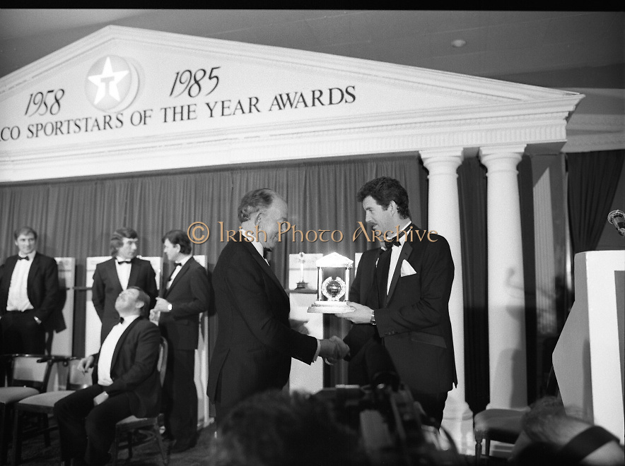 """28th Texaco Sportstar of the Year..1986..15.01.1986..01.15.1986..15th January 1986..At a banquet in the Burlington Hotel,Dublin, the presentation of awards for """"Sportstar"""" of the Year were made. The presentation was carried out by the Tanaiste, Mr Dick Spring TD. The awards were made to the top ten sports people as selected by a panel of judges...Image shows the Tanaiste,Mr Dick Spring TD awarding the Rugby Hall of Fame award to Mr Karl Mullen,one of Irelands' greatest ever rugby players."""