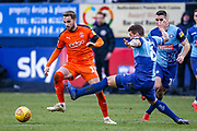Wycombe Wanderers defender Adam El-Abd tackles Luton Town midfielder Andrew Shinnie during the EFL Sky Bet League 1 match between Luton Town and Wycombe Wanderers at Kenilworth Road, Luton, England on 9 February 2019.