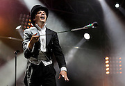 Pelle Almqvist of The Hives perform live on the NME Radio 1 Stage during Day One of Reading Festival 2012 at Richfield Avenue on August 24, 2012 in Reading, England.  (Photo by Simone Joyner)