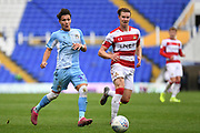 Coventry City midfielder (on loan from Aston Villa) Callum O'Hare (17) sprints forward with the ball  under pressure from Doncaster Rovers midfielder (on loan from Arsenal) Ben Sheaf (6) during the EFL Sky Bet League 1 match between Coventry City and Doncaster Rovers at the Trillion Trophy Stadium, Birmingham, England on 28 September 2019.