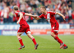 Ben Gibson of Middlesbrough celebrates with goalscorer Grant Leadbitter after Middlesbrough take a 0-1 lead - Photo mandatory by-line: Rogan Thomson/JMP - 07966 386802 - 13/09/2014 - SPORT - FOOTBALL - Huddersfield, England - The John Smith's Stadium - Huddersfield town v Middlesbrough - Sky Bet Championship.