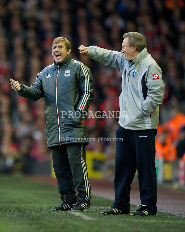 LIVERPOOL, ENGLAND - Saturday, December 10, 2011: Liverpool's manager Kenny Dalglish and Queens Park Rangers' manager Neil Warnock during the Premiership match at Anfield. (Pic by David Rawcliffe/Propaganda)