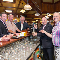 Paul Walsh, Joe Carey, TD, Cllr Paul Murphy, Emelyn Heaps, Micheal Ring, TD, Minister for Sport, and John Power, pulling a pint during the Official opening of 'The Castle', Antique, Arts & Craft Centre in Clarecastle
