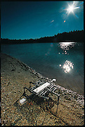 Sidling along the edge of a reservoir outside Boston, MA., Ariel the crab-robot moves with a slow, steady, sideways gait. A machine with a serious purpose, it is designed to scuttle from the shore through the surf to search for mines on the ocean floor. Ariel was funded by the Defense Advanced Research Projects Agency and built by iRobot, a company founded by MIT robot guru Rodney Brooks. Inspired by research on crabs at Robert Full's lab at Berkeley, Ariel takes advantage of the animal's stability and improves on it. But despite its abilities, the technician in charge of the machine, Ed Williams, supervises Ariel's excursions with great anxiety. From the book Robo sapiens: Evolution of a New Species, page 100.
