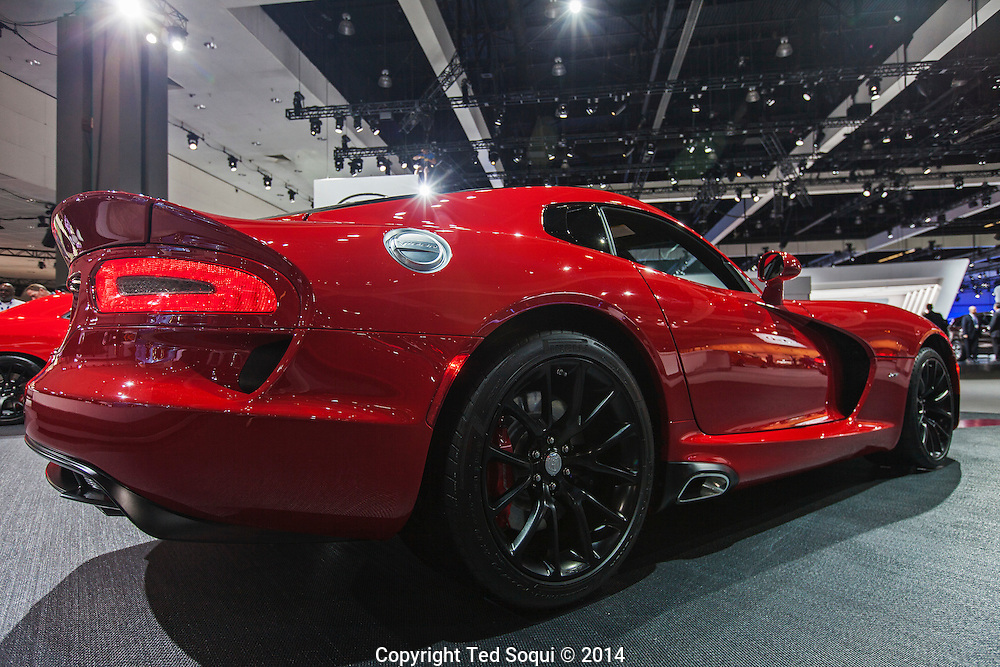 The 2014 Los Angeles Auto Show at the Los Angeles Convention Center.<br />  A red 2015 Viper SRT. It has a 8.4 liter V10 engine that produces 645hp. Cost is $84995 USD.