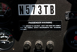 """Passenger Warning"" - The warning sign on the passenger side of an amphibious seaplane."