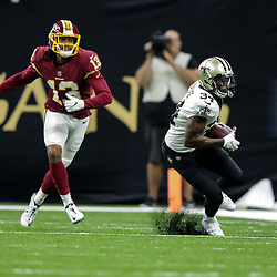 Oct 8, 2018; New Orleans, LA, USA New Orleans Saints cornerback Justin Hardee (34) intercepts a pass ahead of Washington Redskins wide receiver Maurice Harris (13) during the third quarter at the Mercedes-Benz Superdome. The Saints defeated the Redskins 43-19.