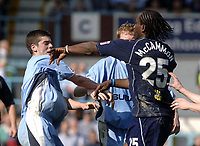 Photo. Glyn Thomas. <br /> Coventry City v Brighton and Hove Albion. <br /> Coca Cola Championship. 02/04/2005.<br /> Brighton's Mark McCammon (R) aims a punch at Coventry's Richard Duffy (L) after Duffy pushed him out of the way after he gets involved in a fracas which arose after Coventry's Michael Doyle sat on top of Brighton's Leon Knight in retaliation after Knight appeared to foul Coventry's Robert Page.