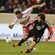 Kenny Cooper, Red Bulls and Dejan Jakovic, D.C. United (right) challenge during the New York Red Bulls V D.C. United Major League Soccer, Eastern Conference Semi Final 2nd Leg match at Red Bull Arena, Harrison. New Jersey. USA. 8th November 2012. Photo Tim Clayton