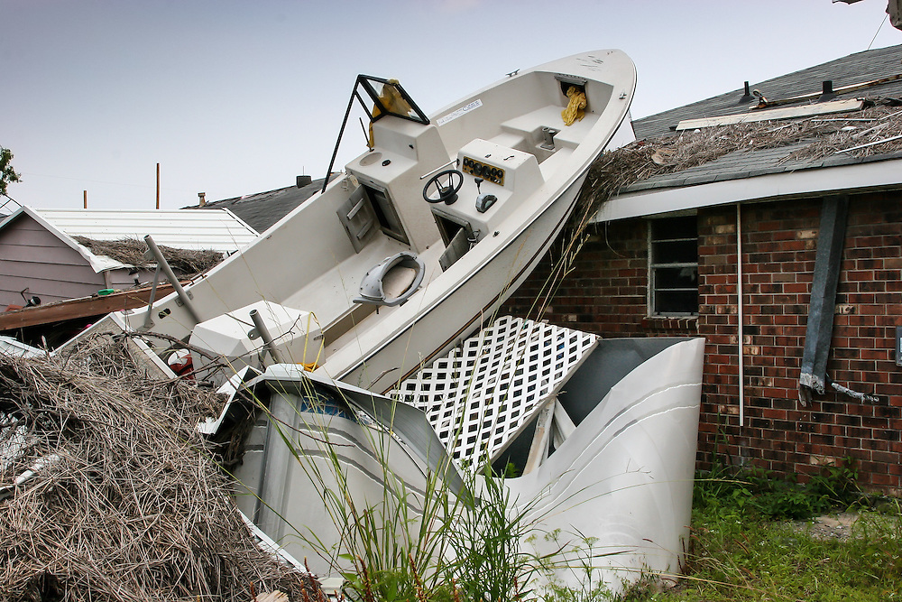 Boat on top of a home destroyed by Hurricane Katrina a year and a half after the storm in New Orleans East.