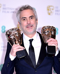 Alfonso Cuaron with his Best Film and Best Director Bafta's in the press room at the 72nd British Academy Film Awards held at the Royal Albert Hall, Kensington Gore, Kensington, London.