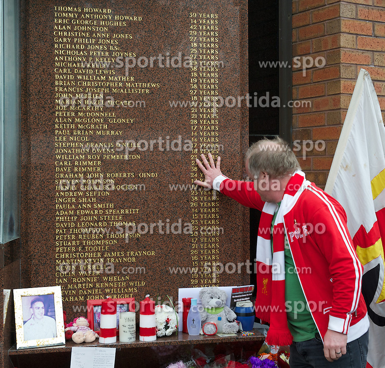 23.09.2012, Anfield, Liverpool, ENG, Premier League, FC Liverpool vs Manchester United, 5. Runde, im Bild A supporter touches the name of a victim of the Hillsborough Stadium Disaster at Liverpool's Hillsborough memorial before The release of the Hillsborough Independent Panel's report shed light on one of the biggest cover-up's in British history which sought to deflect blame from the Police onto the Liverpool supporters during the English Premier League 5th round match between Liverpool FC and Manchester United at Anfield, Liverpool, Great Britain on 2012/09/23. EXPA Pictures © 2012, PhotoCredit: EXPA/ Propagandaphoto/ David Rawcliff..***** ATTENTION - OUT OF ENG, GBR, UK *****