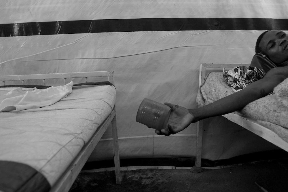 Young boy resting on his bed after eating at CBL Center of Bujumbura ( Center for injured people). @ Martine Perret .24 .October 2005.
