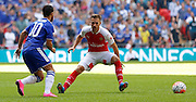 Eden Hazard playing the ball past Aaron Ramsey; during the FA Community Shield match between Chelsea and Arsenal at Wembley Stadium, London, England on 2 August 2015. Photo by Michael Hulf.