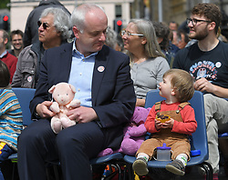 Pictured: Mark Ruskell MSP who is introducing the bill with a young child at the protest.<br /> <br /> Protesters rallied outside the Scottish Parliament as the bill by Mark Ruskell to introduce a 20mph safer streets bill nationwide is set to be debated in the parliament this week.<br /> <br /> © Dave Johnston / EEm