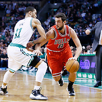 13 February 2013: Chicago Bulls shooting guard Marco Belinelli (8) drives past Boston Celtics shooting guard Courtney Lee (11) during the Boston Celtics 71-69 victory over the Chicago Bulls at the TD Garden, Boston, Massachusetts, USA.