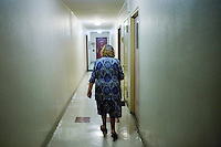 """27 October, 2008. New York. Faina El'man Ryzhikova, 82, a Jewish holocaust survivor and guerilla fighter, walks towards her apartment on the right, in Bensonhurst, Brooklyn, NY. After asking for help, the Edith and Carl Marks Jewish Community House of Bensonhurst assisted her by tapping The New York Times Needieset funds for utility expenses of $50/month for 6 months, the first grant starting on October 3, 2008.<br /> <br /> Faina Ryzhikova was born in 1926 in Radoshkovichi, a little village 22 miles northwest from Minsk, Belarus. Back in 1939, this territory belonged to Poland. When the Germans occupied Radoshkovichi, in 1941, they created a ghetto, where Faina and her family lived and worked. In order to escape a planned pogrom by the Germans in 1942, Faina escaped into the forest where she later met the partisans of the brigade """"Narodnie Mstiteli"""" (Avengers of the people), which she joined.<br /> <br /> Faina's mother and sisters were killed while trying to escape. Her father survived and joined aina in 1943. Of the 2000 people that lived in the Radoshkovichi ghetto, only 18 survived. She married Vladimir Ryzhikov in 1954 and raised two sons. Faina's husband passed away in 1991, before the family came to the United States.<br /> <br /> <br /> ©2008 Gianni Cipriano for The New York Times<br /> cell. +1 646 465 2168 (USA)<br /> cell. +1 328 567 7923 (Italy)<br /> gianni@giannicipriano.com<br /> www.giannicipriano.com"""