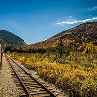 NH White Mountain National Forest is sprinkled in color. A fall train ride along the Conway scenic railroad in Conway, NH to Crawford Notch. <br />