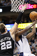 Dallas Mavericks point guard Darren Collison (4) takes the ball to the basket against San Antonio Spurs power forward Tiago Splitter (22) at American Airlines Center in Dallas, Texas, on January 25, 2013.  (Stan Olszewski/The Dallas Morning News)