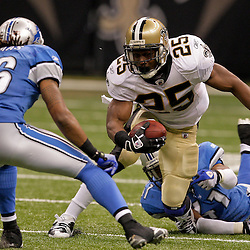 2009 September 13: Detroit Lions defenders William James (41) and Louis Delmas (26) combine to tackle New Orleans Saints running back Reggie Bush (25) during a 45-27 win by the New Orleans Saints over the Detroit Lions at the Louisiana Superdome in New Orleans, Louisiana.