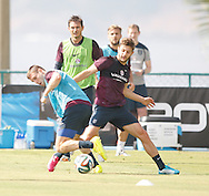 Adam Lallana of England tackles James Milner of England during the England open training session at Est&aacute;dio Claudio Coutinho, Urca, Rio de Janeiro<br /> Picture by Andrew Tobin/Focus Images Ltd +44 7710 761829<br /> 16/06/2014